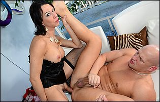 Danika Dreamz in sexy black lingerie and stockings posing and fucking with a guy