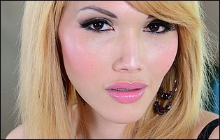 Eva Lin in fishnet stockings likes showing her tight body