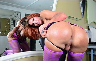 Fernanda Cristine in purple stockings and high heels teasing with tight body