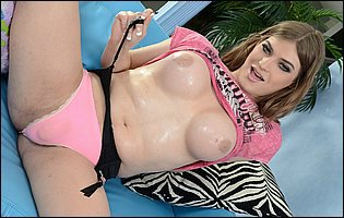 Tiffany Starr in pink t-shirt and panties presents her body
